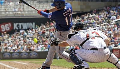 Texas Rangers' Shin-Soo Choo of Korea hits a single in the fourth inning off Minnesota Twins pitcher Samuel Deduno in a baseball game Thursday, May 29, 2014, in Minneapolis. Choo hit a three-run double in the second inning. Catching is Twins' Josmil Pinto. (AP Photo/Jim Mone)