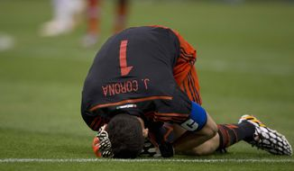 Mexico's goalkeeper Jesus Corona complains writhes in pain after suffering an injury, during a friendly match against Israel in Mexico City, Wednesday, May 28, 2014. (AP Photo/Eduardo Verdugo)