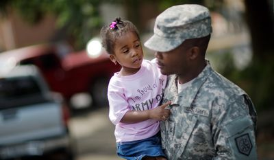 Anslee Harvey, 3, is carried by her father Pfc. Michael Harvey, of Atlanta, with the Georgia National Guard 876th Vertical EN Company, as they leave a departure ceremony before the unit deploys to Afghanistan, Thursday, May 29, 2014, in Toccoa, Ga. The unit's deployment marks the last for the Georgia Army National Guard to Afghanistan as the military looks to withdrawal all but some 10,000 troops after 2014. Officials say the unit's work overseas will include repair, construction, plumbing and more. Officials say the group from Toccoa will be deployed with nearly 150 guardsmen. (AP Photo/David Goldman)