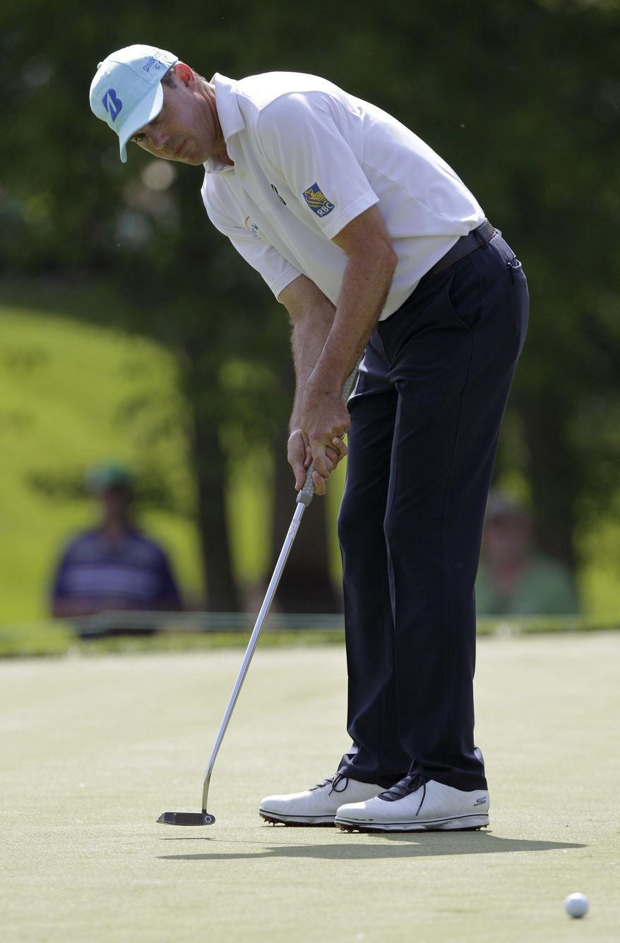 Matt Kuchar putts on the seventh hole during the pro-am for the the Memorial golf tournament Wednesday, May 28, 2014, in Dublin, Ohio. (AP Photo/Jay LaPrete)