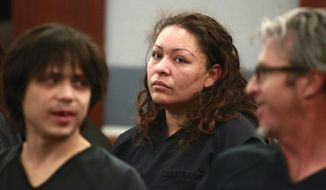 ADDS CITY WHERE CARRILLO WAS APPEARING IN COURT - Shavon Carrillo appears in a Las Vegas court on Thursday, May 29, 2014, on charges of the attempted murder of her 11-year-old son.  Carrillo told investigators she shot the boy because she was distraught about breaking up with his father, her husband of 12 years. Police say Carrillo admitted using methamphetamine and said she thought that if she and her son died, they'd be together. (AP Photo/Las Vegas Sun, Sam Morris)