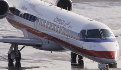 ** FILE ** In this Jan. 20, 2011, file photo, an American Eagle jet taxis at Boston's Logan International Airport. (AP Photo/Stephan Savoia, File)