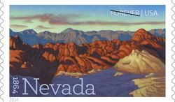 This image provided by the U.S. Postal service shows a new postage stamp commemorating Nevada's 150th birthday, unveiled Thursday May 29, 2014 in Las Vegas. The design is an oil painting of Fire Canyon, which is part of Valley of Fire State Park in southern Nevada. Reno artist Ron Spears painted the landscape. (AP Photo/US Postal Service)
