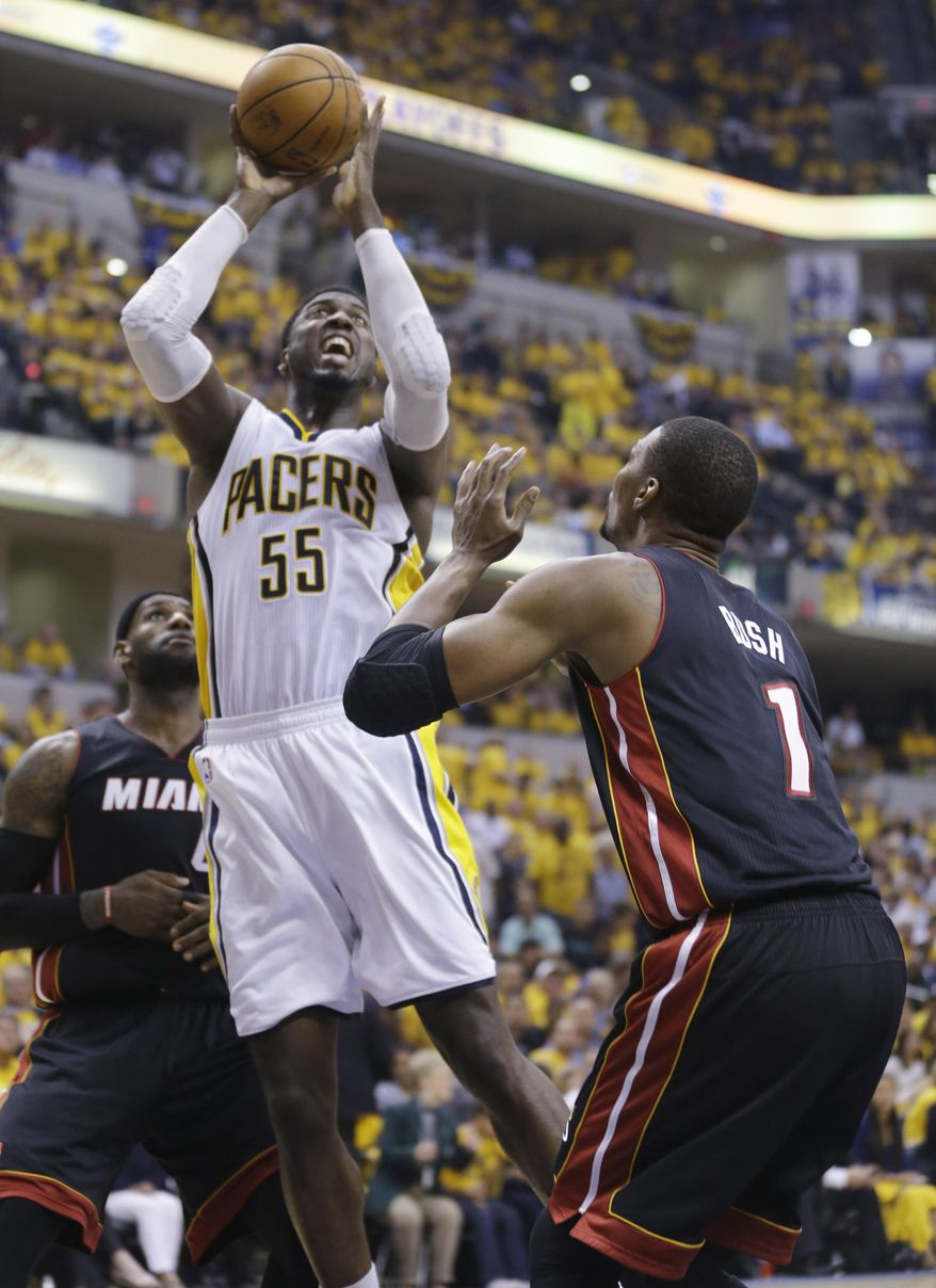 Indiana Pacers center Roy Hibbert (55) shoots over Miami Heat center Chris Bosh (1) during the second half of Game 5 of the NBA basketball Eastern Conference finals in Indianapolis, Wednesday, May 28, 2014. (AP Photo/Michael Conroy)