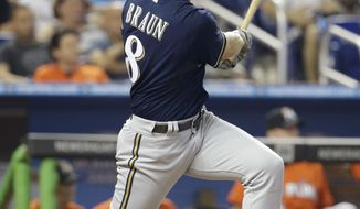 Milwaukee Brewers' Ryan Braun follows through on a single in the fourth inning during a baseball game against the Miami Marlins, Sunday, May 25, 2014, in Miami. The Brewers defeated the Marlins 7-1. (AP Photo/Lynne Sladky)