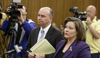 Youngstown Mayor John McNally, left, stands with his attorney, Lynn Maro, before a judge during his arraignment Thursday, May 29, 2014, in Cleveland. McNally was charged with racketeering and bribery. McNally is accused of working with a Youngstown businessman to prevent Mahoning County from moving county offices to another site. (AP Photo/Tony Dejak)