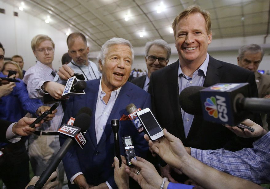 NFL Commissioner Roger Goodell and New England Patriots owner Robert Kraft, left, address members of the media during a football safety clinic for mothers, Thursday, May 29, 2014, at the team's facilities in Foxborough, Mass. (AP Photo/Stephan Savoia)