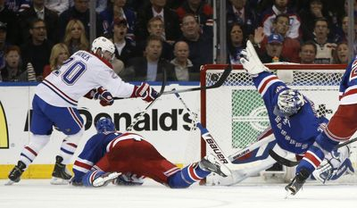 New York Rangers goalie Henrik Lundqvist (30) blocks a shot by Montreal Canadiens left wing Thomas Vanek (20) during the second period in Game 6 of the NHL hockey Stanley Cup playoffs Eastern Conference finals, Thursday, May 29, 2014, in New York. (AP Photo/Kathy Willens)