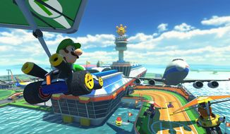 "This image released Nintendo shows a scene from the video game ""Mario Kart 8."" (AP Photo/Nintendo)"