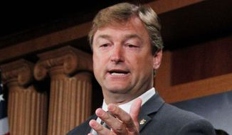 "Sen. Dean Heller, Nevada Republican, said he will continue to ""work on a path forward"" on legislation to extend unemployment benefits, said a spokesperson. (Associated Press)"