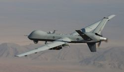 A MQ-9 Reaper, armed with GBU-12 Paveway II laser guided munitions and AGM-114 Hellfire missiles, is piloted by Col. Lex Turner during a mission over southern Afghanistan. (USAF via Associated Press)