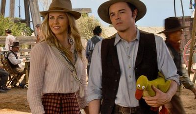 "Seth MacFarlane (right) starring as sheep farmer Albert, is joined by Charlize Theron in a scene from ""A Million Ways to Die in the West."" Mr. MacFarlane also directed and co-wrote the movie, which is at once a deeply crude movie and a surprisingly sweet one. (Universal Pictures via Associated Press)"