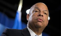 In this March 18, 2014, file photo, Department of Homeland Security Secretary Jeh Johnson speaks during a news conference in Washington. Johnson, who's conducting a politically charged review of the nation's deportation policy, said Thursday, May 15 he's looking at making changes to a much-criticized program that runs people booked for local crimes through a federal immigration database.(AP Photo/ Evan Vucci, File)