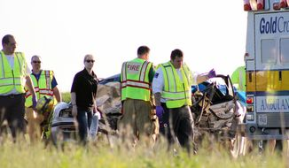 Emergency personnel from around Freeborn County, Minnesota, respond to a double fatality on Interstate 35 one mile north of the Iowa border Wednesday, May 29, 2014.  (AP Photo/Albert Lea Tribune, Sarah Stultz)