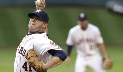 Houston Astros' Brad Peacock (41) delivers a pitch against the Baltimore Orioles with second baseman Jose Altuve in the background during the first inning of a baseball game Thursday, May 29, 2014, in Houston. (AP Photo/Pat Sullivan)