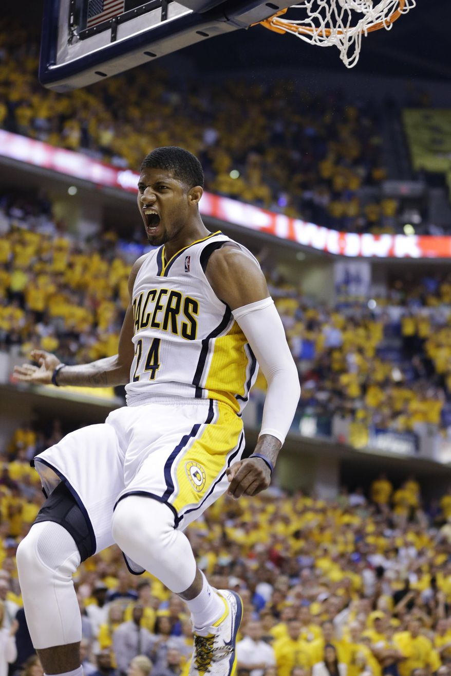 Indiana Pacers forward Paul George celebrates after dunking against the Miami Heat during the second half of Game 5 of the NBA basketball Eastern Conference finals in Indianapolis, Wednesday, May 28, 2014. (AP Photo/Michael Conroy)