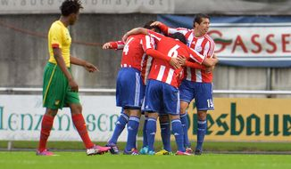 Paraguay's players celebrate after scoring, during their friendly soccer match against Cameroon in Kufstein, Austrian province of Tyrol, Thursday, May 29. 2014. (AP Photo/Kerstin Joensson)