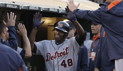 Detroit Tigers' Torii Hunter (48) is congratulated after hitting a solo home run off of Oakland Athletics pitcher Scott Kazmir during the fourth inning of a baseball game in Oakland, Calif., Wednesday, May 28, 2014. (AP Photo/Jeff Chiu)