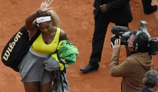 Serena Williams of the U.S. leaves after losing her second round match of the French Open tennis tournament in two sets 2-6, 2-6, against Spain's Garbine Muguruza at the Roland Garros stadium, in Paris, France, Wednesday, May 28, 2014. (AP Photo/Darko Vojinovic)