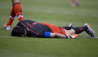 Mexico's goalkeeper Jesus Corona complains of pain after suffering an injury, during a friendly match against Israel in Mexico City, Wednesday, May 28, 2014. (AP Photo/Eduardo Verdugo)