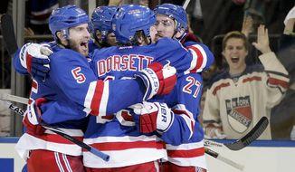 The New York Rangers celebrate after a second period goal by center Dominic Moore (28) against the Montreal Canadiens in Game 6 of the NHL hockey Stanley Cup playoffs Eastern Conference finals, Thursday, May 29, 2014, in New York. (AP Photo/Kathy Willens)