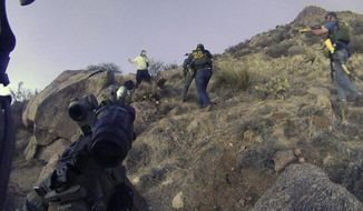 FILE - This March 16, 2014 photo of an Albuquerque Police Department lapel camera still, shows a standoff with James Boyd, before firing six shots at the man. Police say Boyd, 38, refused to drop a knife and had threatened to kill officers. An autopsy report released Thursday May 29, 2014, says Boyd, a homeless man shot and killed by Albuquerque police had multiple surgeries and his arm amputated before he died. That shooting sparked widespread calls for Albuquerque police reform, and U.S. Justice Department then released a scathing review of the agency's use of force. (AP Photo/Albuquerque Police Department, File)