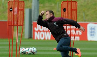 England's Wayne Rooney during a training session at George's Park in Burton on Trent, England, Tuesday, May 27, 2014. England play an international soccer friendly against Peru at Wembley on Friday May 30th. (AP Photo/Rui Vieira)