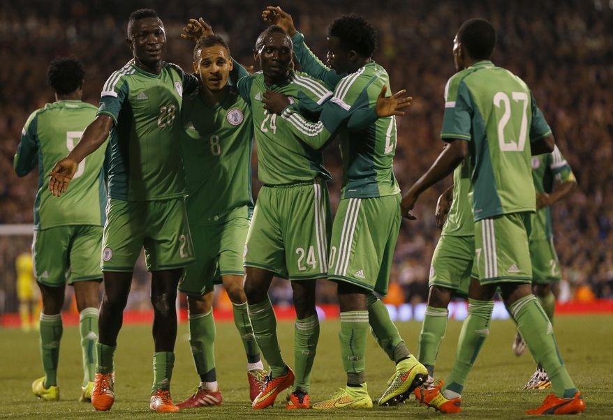 Nigeria's Uche Nwofor, centre, celebrates with team mates after he scores a goal during the international friendly soccer match between Nigeria and Scotland at Craven Cottage Stadium in London, Wednesday, May 28, 2014. (AP Photo/Kirsty Wigglesworth)