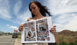 Wasatch High School sophomore Kimberly Montoya, 16, points to her altered school yearbook photo, upper left, Thursday, May 29, 2014, in Heber City, in Utah. A group of Utah high school students, including Montoya, said they were shocked and upset to discover their school yearbook photos were digitally altered, with sleeves and higher necklines drawn on to cover up bare skin.  (AP Photo/Rick Bowmer)