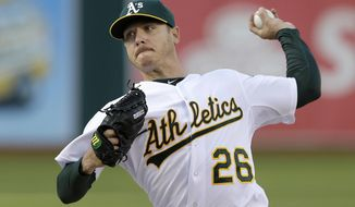 Oakland Athletics pitcher Scott Kazmir throws against the Detroit Tigers during the first inning of a baseball game in Oakland, Calif., Wednesday, May 28, 2014. (AP Photo/Jeff Chiu)