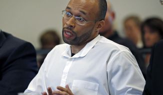 Frederick Christian speaks on his own behalf during a hearing before the state's parole board in Natick, Mass., Thursday, May 29, 2014. Christian, who has been in prison for twenty years for a premeditated robbery which resulted in two dead and one injured, is appealing for release after Massachusetts' highest court struck down mandatory life sentences for juveniles in December. (AP Photo/Elise Amendola)