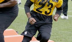 Pittsburgh Steelers safety Mike Mitchell, (23) goes through drills with the defense during an NFL football organized team activity on Thursday, May 29, 2014 in Pittsburgh. (AP Photo/Keith Srakocic)