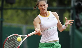 Germany's Andrea Petkovic returns the ball to Switzerland's Stefanie Voegele during their second round match of  the French Open tennis tournament at the Roland Garros stadium, in Paris, France, Thursday, May 29, 2014. (AP Photo/David Vincent)