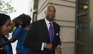 Former District of Columbia Councilmember Michael A. Brown arrives at U.S. District Court in Washington, Thursday, May 29, 2014. Brown could be sentenced to nearly four years in prison for taking more than $50,000 in bribes in an undercover FBI sting.  (AP Photo/Molly Riley)