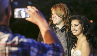 Caleb Johnson and Jena Irene talk about their American Idol experience before attending her North Farmington High School Prom at the Dearborn Inn in Dearborn, Mich. on Wednesday, May 28, 2014.  (AP Photo/Detroit Free Press, Jarrad Henderson)  DETROIT NEWS OUT;  NO SALES