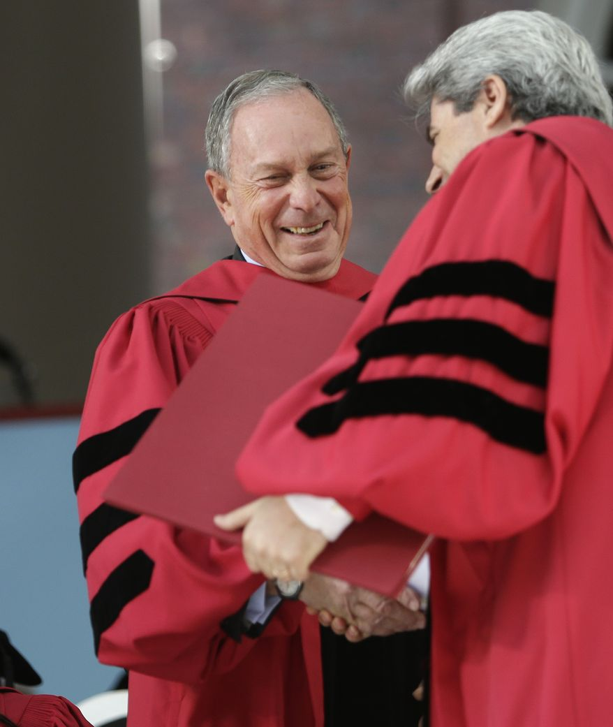 Former Mayor of New York Michael Bloomberg, left, shakes hands with Vice President and Secretary of Harvard University Marc Goodheart, right, as he is awarded with an honorary Doctor of Laws degree during Harvard commencement ceremonies, Thursday, May 29, 2014, in Cambridge, Mass. (AP Photo/Steven Senne)