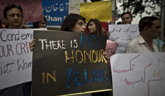 Members of Pakistan's civil society hold banners during a protest to condemn the killing of pregnant woman Farzana Parveen, who was stoned to death in Islamabad, Pakistan, Thursday, May 29, 2014. A senior police official in Pakistan said Mohammed Iqbal, husband of the woman stoned to death by her family earlier this week, was arrested for killing his first wife, though the case against him was withdrawn. Iqbal's second wife was bludgeoned to death Tuesday in the eastern city of Lahore by family members. Iqbal and his wife's lawyer said the family was angry because they wanted her to marry someone else. (AP Photo/Muhammed Muheisen)