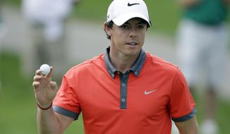 Rory McIlroy, of Northern Ireland, reacts following a birdie on the 13th hole during the first round of the Memorial golf tournament Thursday, May 29, 2014, in Dublin, Ohio. (AP Photo/Darron Cummings)