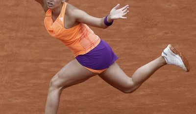 Argentina's Paula Ormaechea returns the ball during the third round match of the French Open tennis tournament against Russia's Maria Sharapova at the Roland Garros stadium, in Paris, France, Friday, May 30, 2014. (AP Photo/Michel Euler)