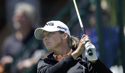 Angela Stanford hits a tee shot on the first hole during the first round of the ShopRite LPGA Classic golf tournament in Galloway Township, N.J., Friday, May 30, 2014. (AP Photo/Mel Evans)