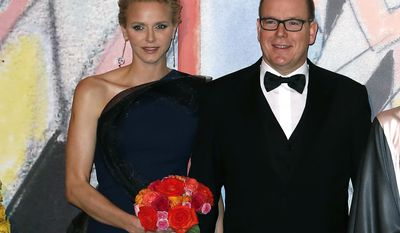 "FILE-  In this Saturday, March 29, 2014 file photo, Prince Albert II of Monaco, and his wife Princess Charlene pose for photographers as they arrive at the Rose Ball for the 50th anniversary of the Princess Grace Foundation, in Monaco. Princess Charlene of Monaco, who married Prince Albert II in 2011, has announced she is pregnant with the pair's first baby. The 36-year-old South African former Olympic swimmer and her husband issued a statement expressing their ""immense joy"" at the news. The short statement says that the birth is expected before the end of the year, which means the princess is at least three months pregnant. (AP Photo, file)"