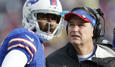 FILE - In this Nov. 17, 2013 file photo, Buffalo Bills head coach Doug Marrone, right, and Buffalo Bills quarterback EJ Manuel talk during the first half of an NFL football game against the New York Jets, in Orchard Park, N.Y.  Leaving the Bills defense to new coordinator Jim Schwartz, Marrone is making the retooled EJ Manuel-led offense his primary focus during the team's spring minicamp sessions.(AP Photo/Gary Wiepert, File)