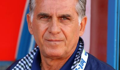 Iran's Portuguese  coach Carlos Queiroz looks on during a friendly soccer match between Iran and Angola, in Hartberg, Austria, Friday, May 30, 2014. (AP Photo/Ronald Zak)