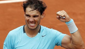 Spain's Rafael Nadal clenches his fist after defeating Austria's Dominic Thiem during the second round match of  the French Open tennis tournament at the Roland Garros stadium, in Paris, France, Thursday, May 29, 2014. Nadal won 6-2, 6-2, 6-3. (AP Photo/Darko Vojinovic)