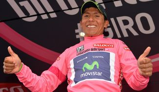 Colombia's Nairo Quintana celebrates on the podium after completing the 18th stage of the Giro d'Italia cycling race from Belluno to Rifugio Panarotta, Italy, Thursday, May 29, 2014. Julian Arredondo of Colombia claimed the biggest win of his career with a solo victory on the 18th stage of the Giro d'Italia on Thursday, while Nairo Quintana retained the overall leader's pink jersey as the race returned to the mountains. (AP Photo/Gian Mattia D'Alberto)