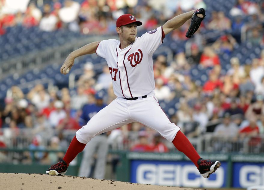 Washington Nationals starting pitcher Stephen Strasburg delivers the ball to the Texas Rangers during the first inning of a baseball game on Friday, May 30, 2014, in Washington. (AP Photo/Luis M. Alvarez)