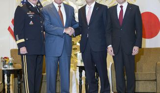U.S. Defense Secretary Chuck Hagel, second from left, poses with Japanese Prime Minister Shinzo Abe, second from right, right, before their meeting, Friday, May 30, 2014 in Singapore. Also joining them are Japanese Defense Minister Itsunori Onodera, right, and Gen. Martin Dempsey, left, chairman of the Joint Chiefs of Staff. Hagel is in Singapore to attend the 13th Asia Security Summit. (AP Photo/Pablo Martinez Monsivais, Pool)