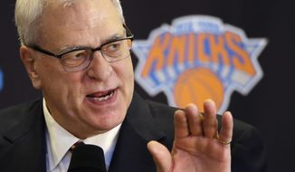 FILE - In this March 18, 2014 file photo, Phil Jackson answers questions during a news conference in New York. Jackson is expected to provide an update on his search for a coach, Friday, May 30, 2014. (AP Photo/Mark Lennihan, File)
