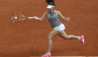 Croatia's Ajla Tomljanovic returns the ball during the third round match of the French Open tennis tournament against Poland's Agnieszka Radwanska at the Roland Garros stadium, in Paris, France, Friday, May 30, 2014.  (AP Photo/Michel Euler)