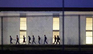 Immigrant children who come into the U.S. alone are housed in shelters like this one in Harlingen, Texas which is licensed to hold up to 290. Some 60,000 children and teens are expected to be caught in the U.S. illegally without a parent or a guardian this year. (AP Photo/Houston Chronicle, Johnny Hanson)